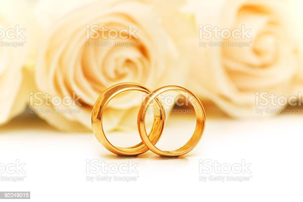 Roses and wedding rings isolated on the white picture id92249015?b=1&k=6&m=92249015&s=612x612&h=z41lxleycjesn6bacokq r p9pek wvpsfg8dgbc lq=