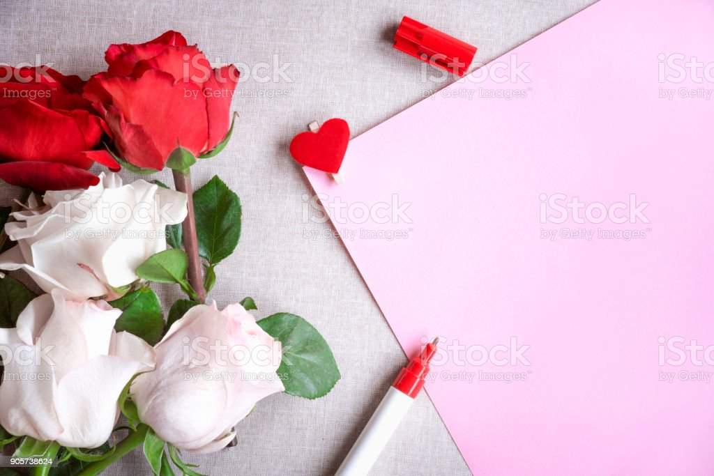 Roses bouquet and blank paper sheet stock photo