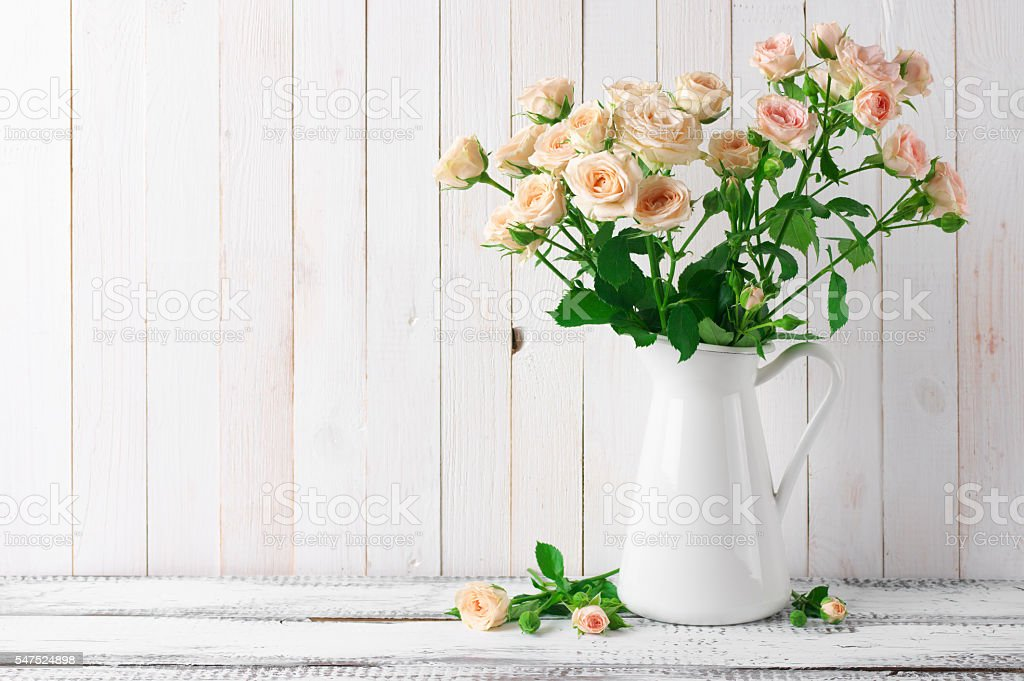 Roses bouquet in jug stock photo