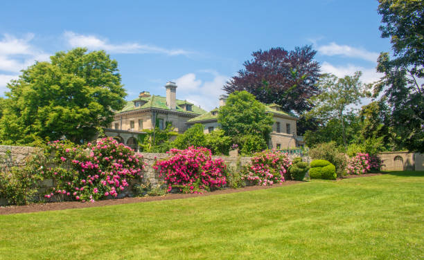 Roses climb the stone wall near the mansion in Harkness Memorial State Park stock photo
