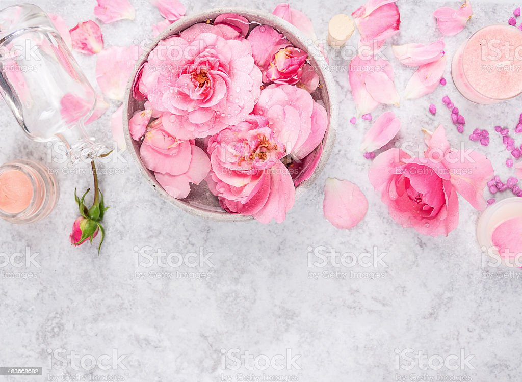 Roses cosmetics set with cream,bottle, petals and sea salt stock photo