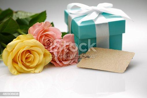 155315629istockphoto roses & gift 480908608