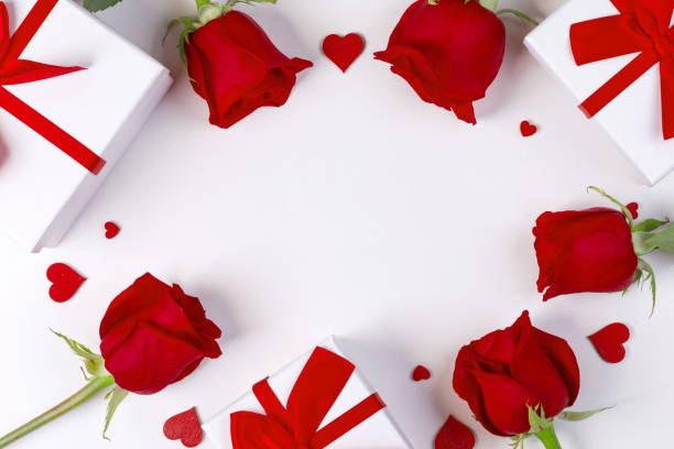 Roses gifts and hearts card stock photo
