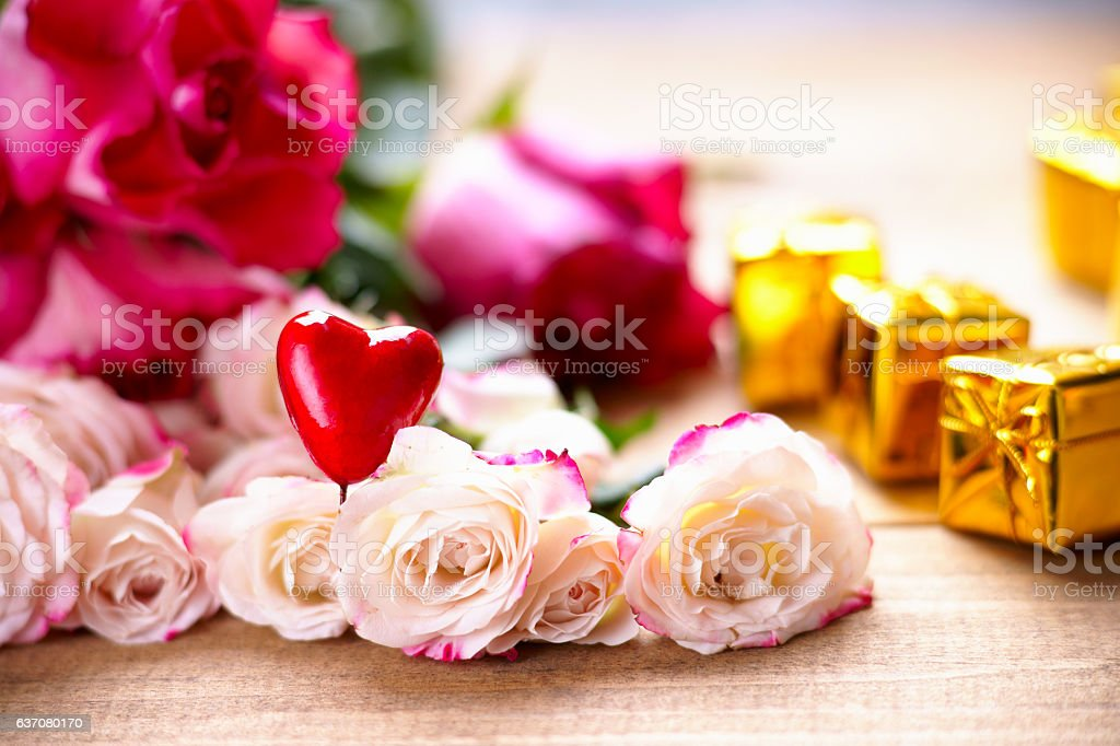 Roses, heart shape and gift boxes stock photo