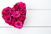 istock roses in a heart-shaped bowl 626095768