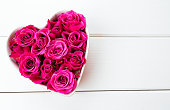 istock roses in a heart-shaped bowl 626333148