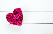 istock roses in a heart-shaped bowl 626512398