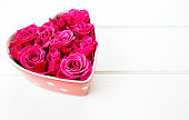 istock roses in a heart-shaped bowl 626660836