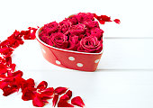 istock roses in a heart-shaped bowl 638382114
