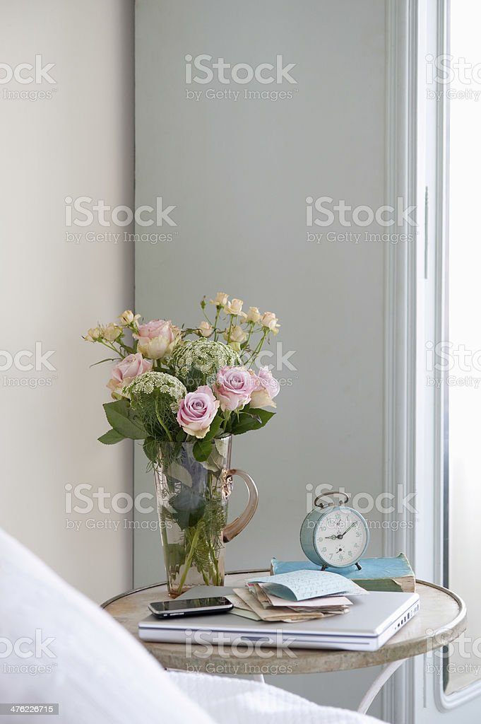 Roses In Vase On Bedside Table stock photo