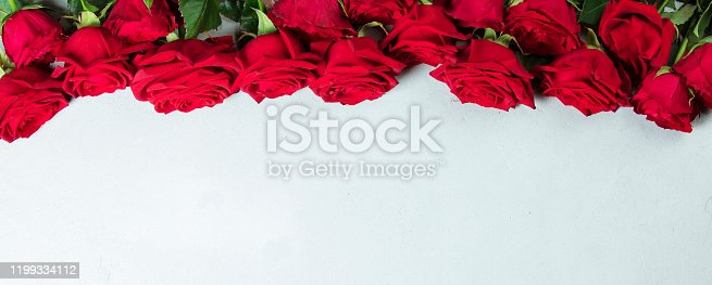 Valentine's day red roses and beautiful flowers for your special someone sitting on kitchen counter waiting for you to come home to