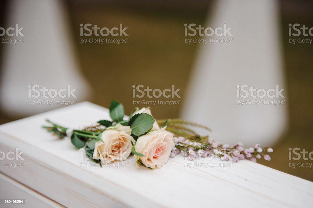 Roses on the wedding box. Ceremony. Wedding decorations. stock photo