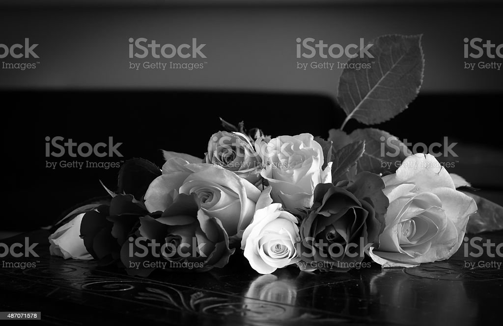 Roses on Vintage Table - Black and White stock photo