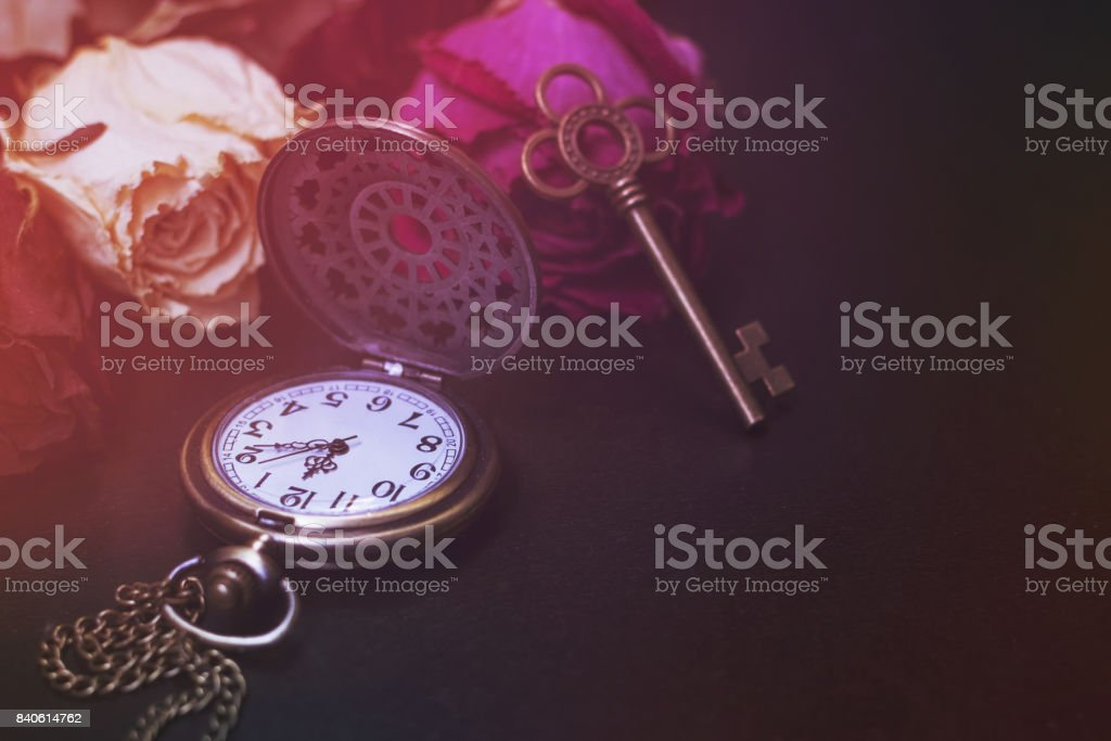 Roses,  pocket watch and old key stock photo