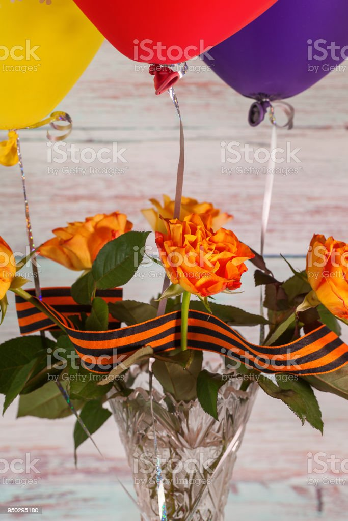 Roses with multicolored balloons and St. George ribbon stock photo