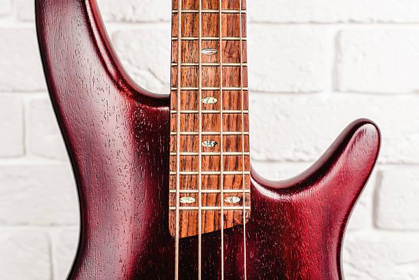 Rosewood bass electric guitar closeup stock photo