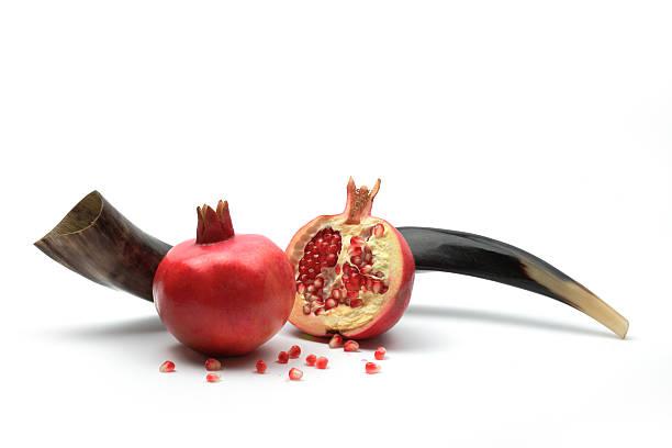 Rosh Hashana concept Shofar and pomegranates, isolated rosh hashanah stock pictures, royalty-free photos & images