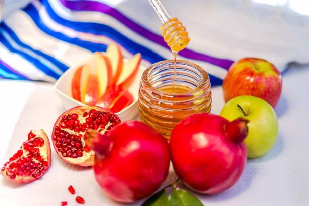 Rosh HaShana - Jewish New Year emblems Rosh HaShana traditional emblems - pomegranate, apple and honey rosh hashanah stock pictures, royalty-free photos & images