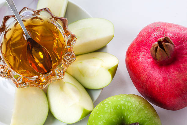 Rosh Hashana Apples with honey and pomegranate for Rosh Hashana rosh hashanah stock pictures, royalty-free photos & images