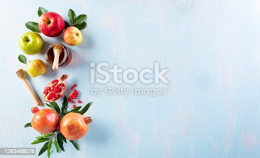 istock Rosh hashanah (jewish New Year holiday), Concept of traditional or religion symbols on pastel blue background. 1263468078