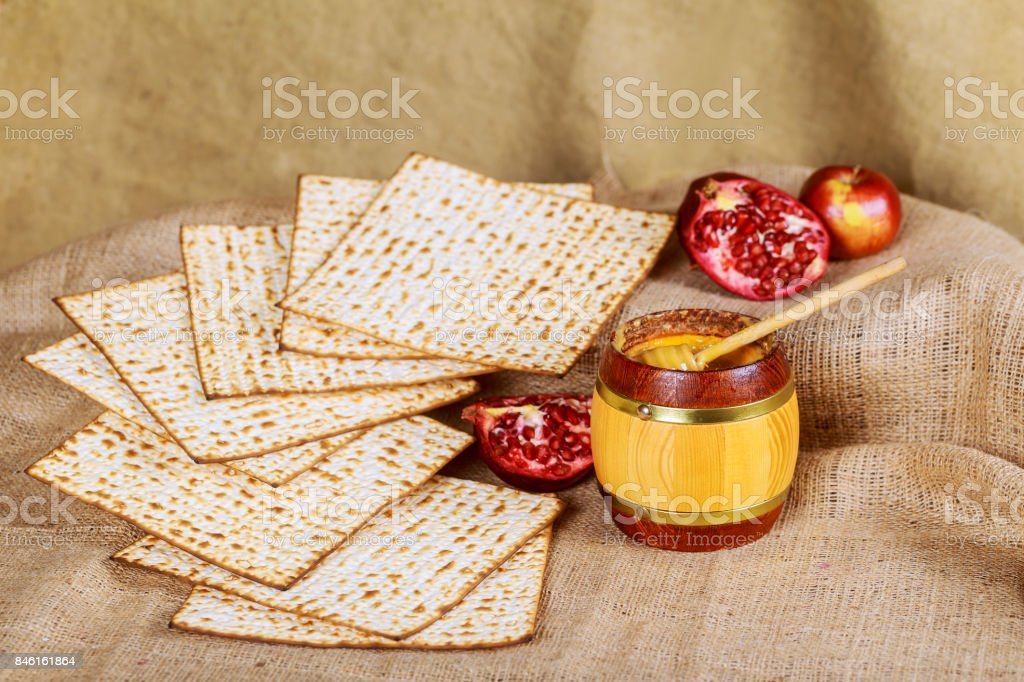 rosh hashanah jewesh holiday concept - honey, apple and pomegranate stock photo