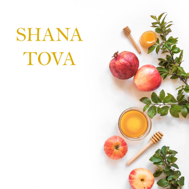Rosh Hashanah Rosh Hashanah jewish New Year holiday concept. Creative layout of traditional symbols - apples, honey, pomegranate isolated on white, top view, copy space. rosh hashanah stock pictures, royalty-free photos & images