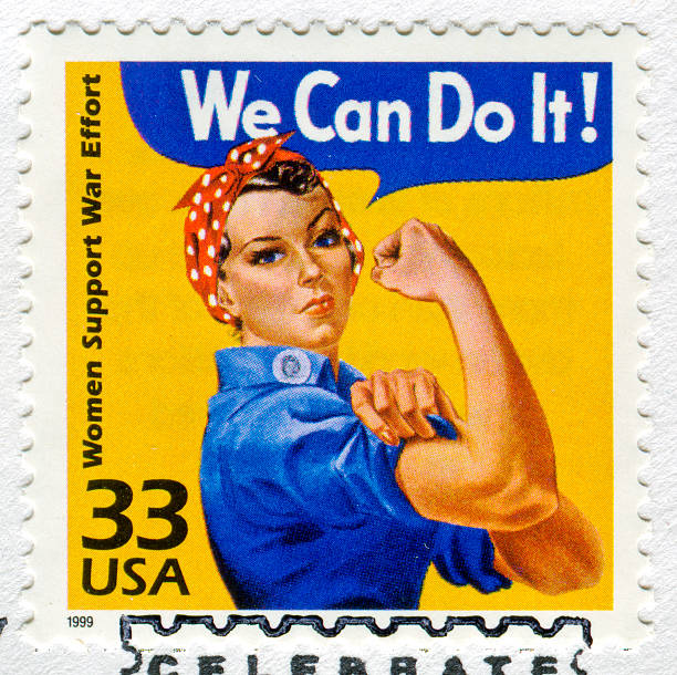 """Rosie The Riveter Stamp Richmond, Virginia, USA - November 2nd, 2011: Cancelled Stamp From The United States Featuring Rosie The Riveter Saying """"We Can Do It!"""".  On The Side Of The Stamp It Reads """"Woman Support War Effort"""". suffragist stock pictures, royalty-free photos & images"""