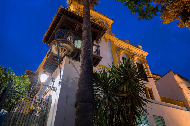 Rosina's Balcony from the Barber of Seville Seville, Spain - October 23, 2018: Medieval house in old Juderia (Jewish Quarter). According to the legend, this charming corner balcony inspired the the Barber of Seville. santa cruz seville stock pictures, royalty-free photos & images