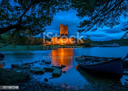 Killarney, Republic of Ireland - August 16th 2018: A dusk-time view of the magnificent Ross Castle, located on the edge of Lough Leane in Killarney National Park, Republic of Ireland.