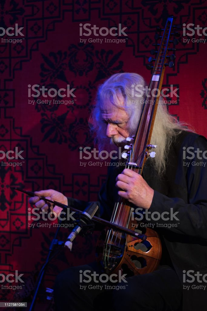 Ross Daly performing stock photo
