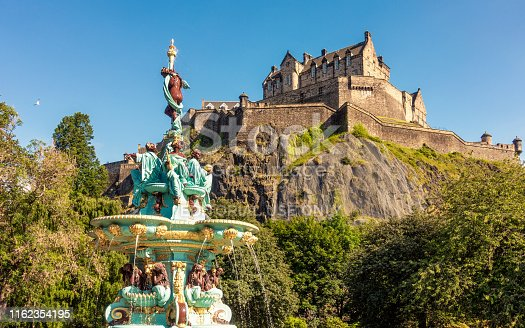 Edinburgh, Scotland - The newly restored and repainted Ross Fountain in Princes Street Gardens, with Edinburgh Castle in the background.