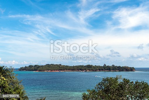 Ross island is the top view. A small island in the center of the ocean. on blue sky background and clouds