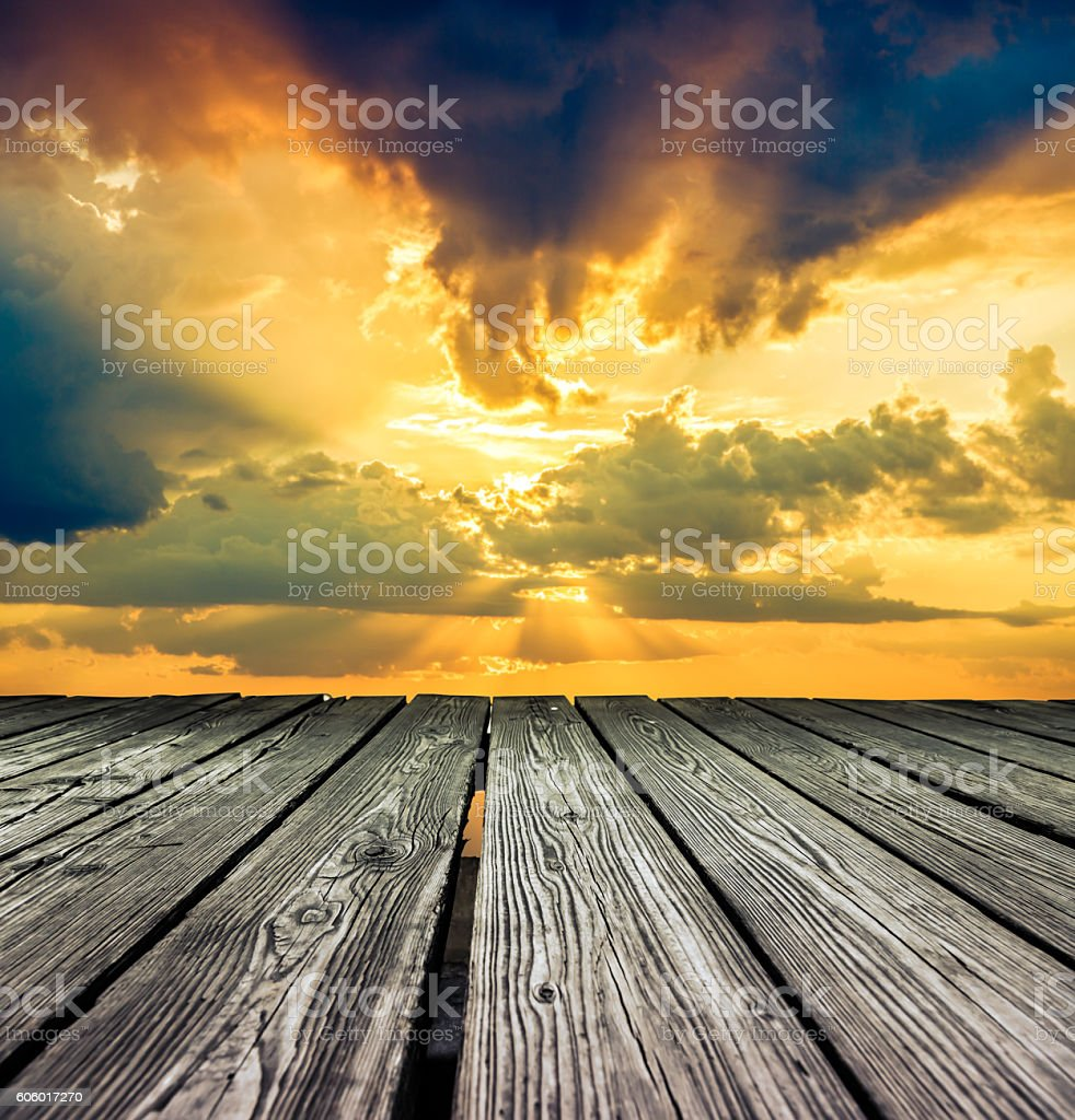 Rostrum made of wooden planks on sky before sunset stock photo