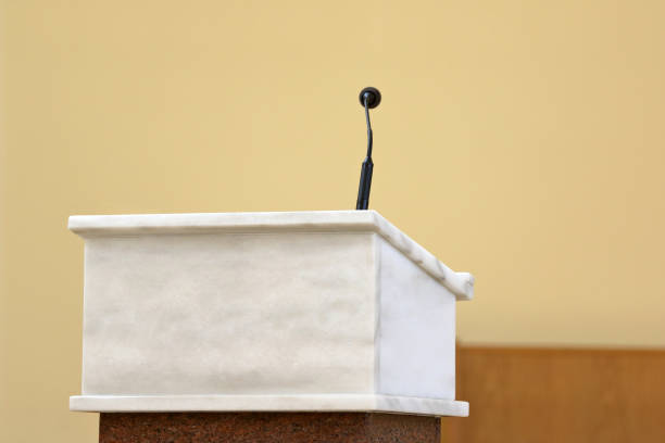 Rostrum with microphone in conference hall or church altar Rostrum with microphone in conference hall or church altar and empty space for text pulpit stock pictures, royalty-free photos & images