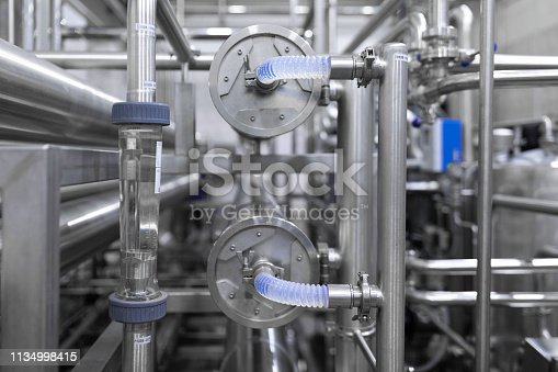 1132919452istockphoto Rotameter and chrome pipes. Industrial background 1134998415