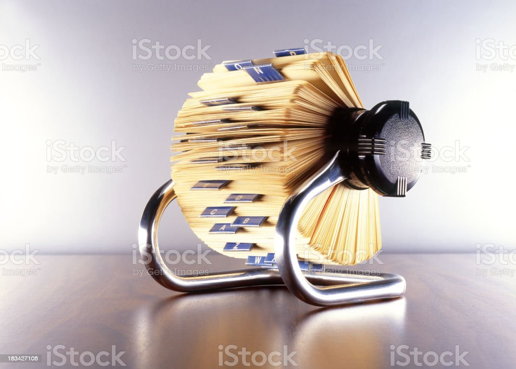 A rotary file, alone on a wooden surface stock photo
