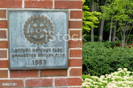Rochester, Michigan, USA - August 10, 2014: Entry to the Rotary Gateway Park, a city park in downtown Rochester, Michigan. Rotary International is a charity with members around the world.