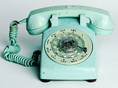 Vintage rotary telephone on white background.