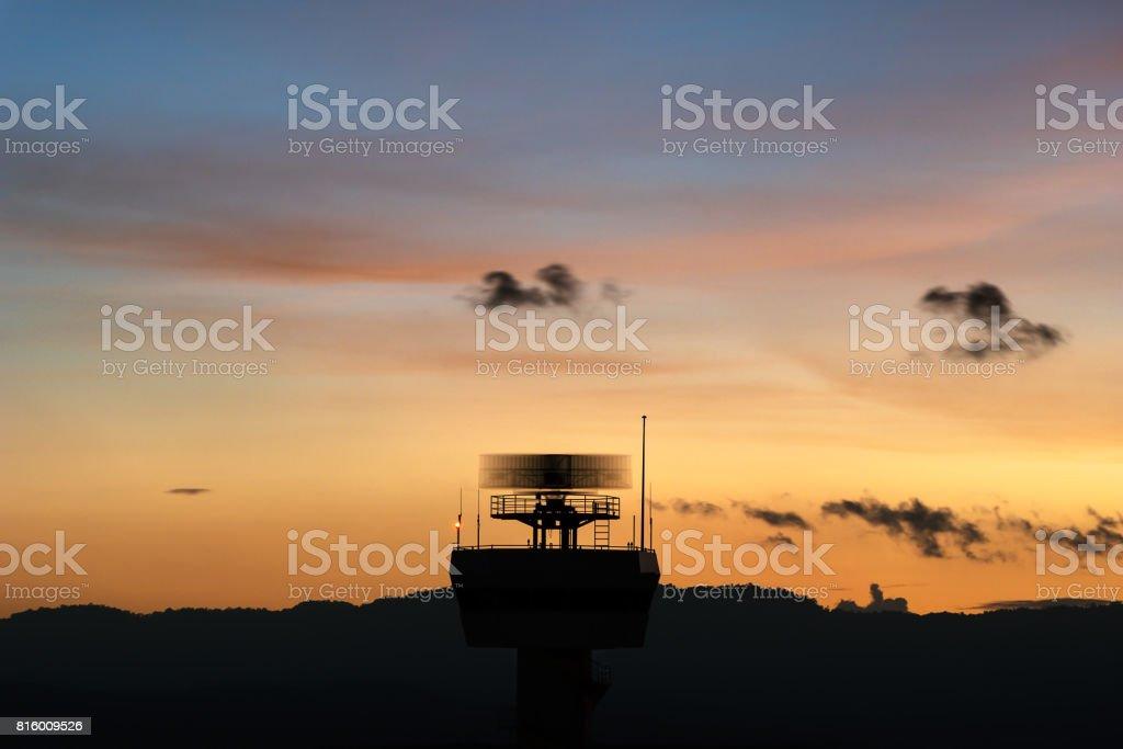 Rotating antenna secondary surveillance radar with twilight sky stock photo