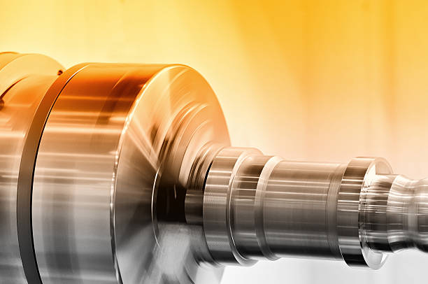 Rotating spindle of turning lathe and metal detail - Photo