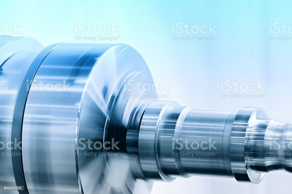Rotating spindle of turning lathe and metal detail stock photo