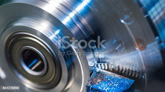 istock Rotating workpiece with blurred splinter. Beautiful motion blur 844226890