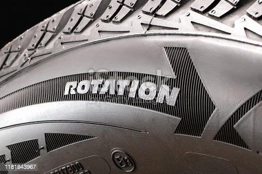rotation-arrow indicating the rolling direction of the tire to properly install the wheel on the car. the designation on the sidewall of the tire