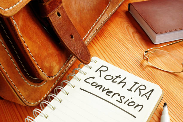 Roth ira conversion memo near retro briefcase and glasses. Roth ira conversion memo near retro briefcase and glasses. roth conversion stock pictures, royalty-free photos & images