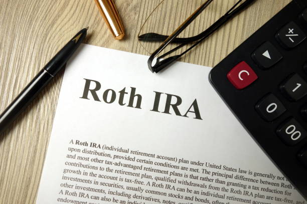 Roth IRA mockup with calculator pen and glasses stock photo