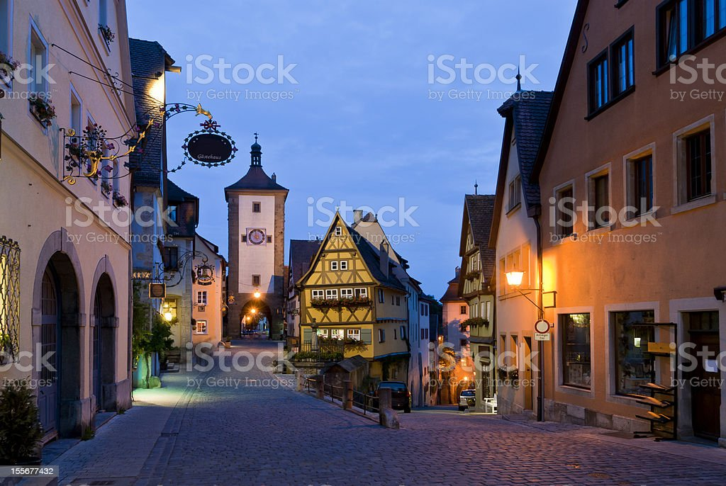 Rothenburg , Germany. Medieval Town with Plonlein Square in romantic twilight. royalty-free stock photo