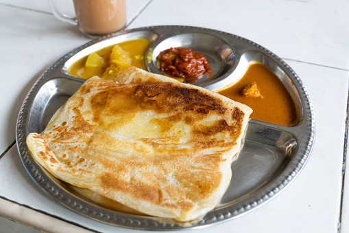 Roti planta is popular breakfast in Malaysia. It is roti canai with added margarine.