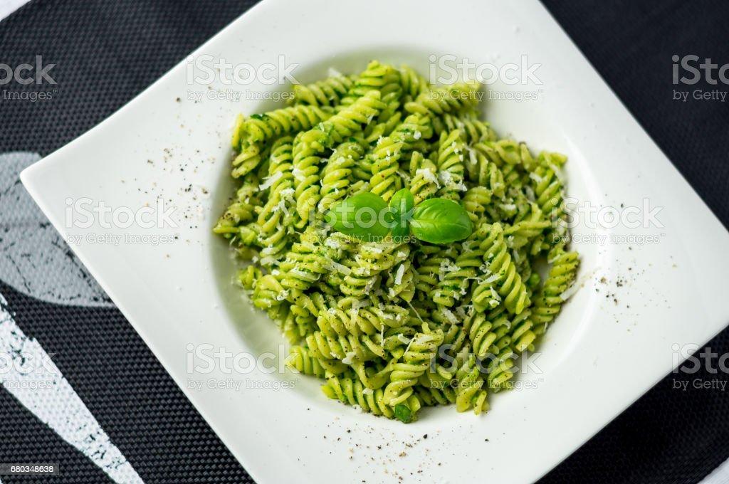 Rotini pesto pasta top view. stock photo