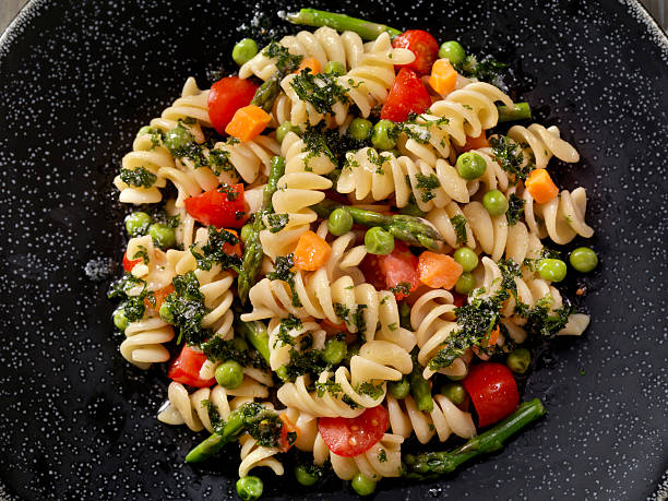 Rotini Primavera in a Browned Butter and Garlic Sauce Rotini Primavera in a Browned Butter and Garlic Sauce - Photographed on Hasselblad H3D2-39mb Camera fusilli stock pictures, royalty-free photos & images