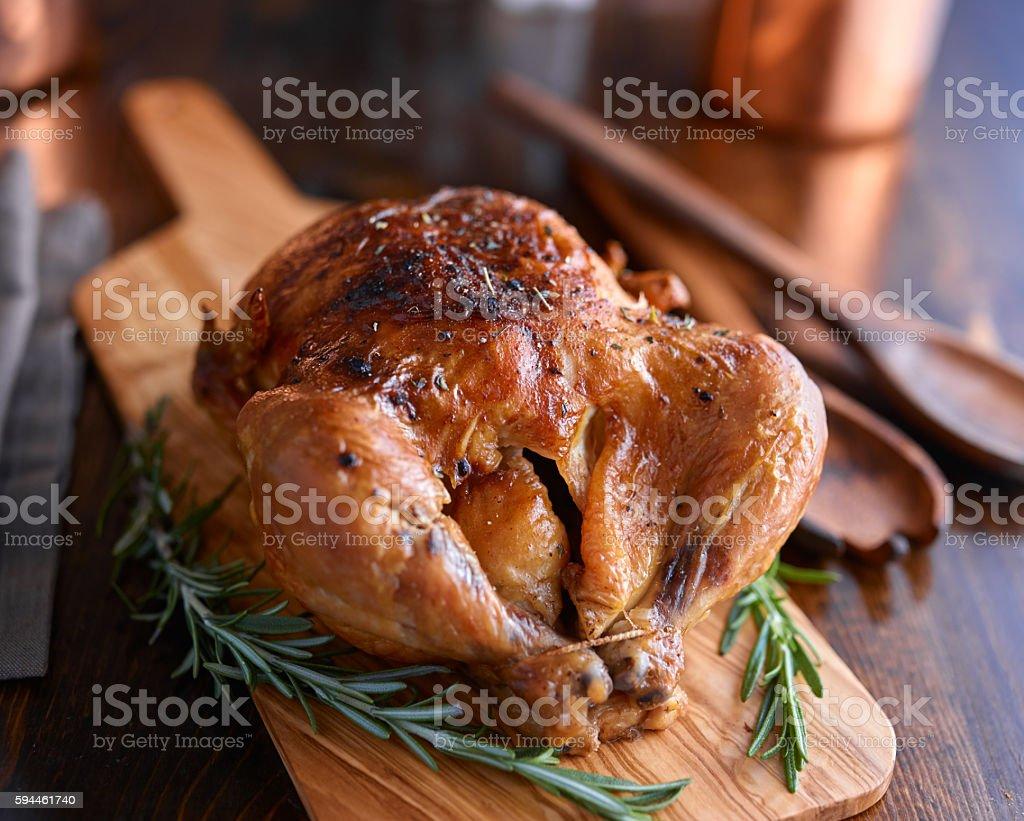 rotisserie chicken with herbs stock photo